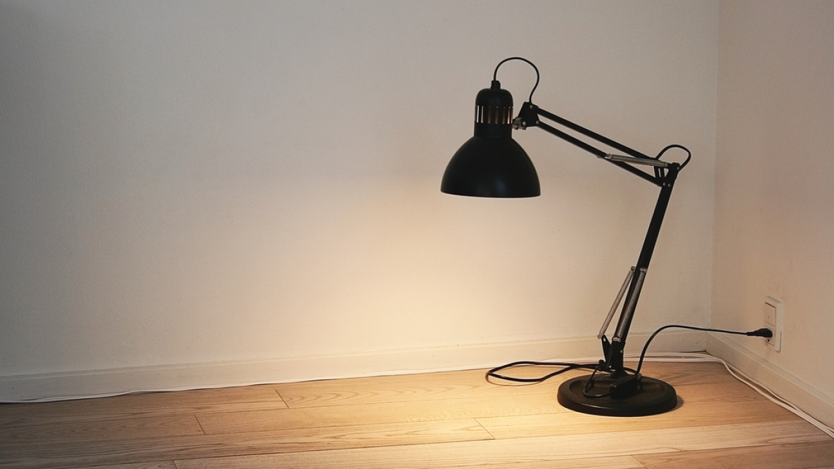 lamp in a corner of a white room