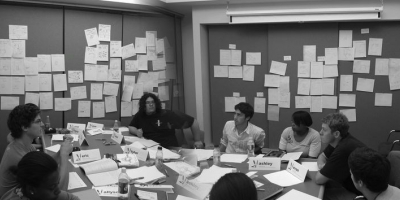 A group of people strategizing and brainstorming