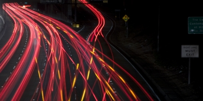 night highway traffic at exit