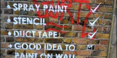 Checklist on brick wall. Spray paing, stencil, duct tape, good idea to paint on wall