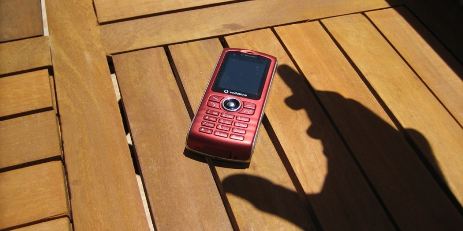 hand shadow answering mobile phone