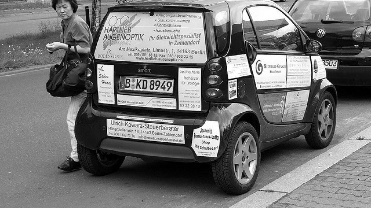Smart car plastered with ads